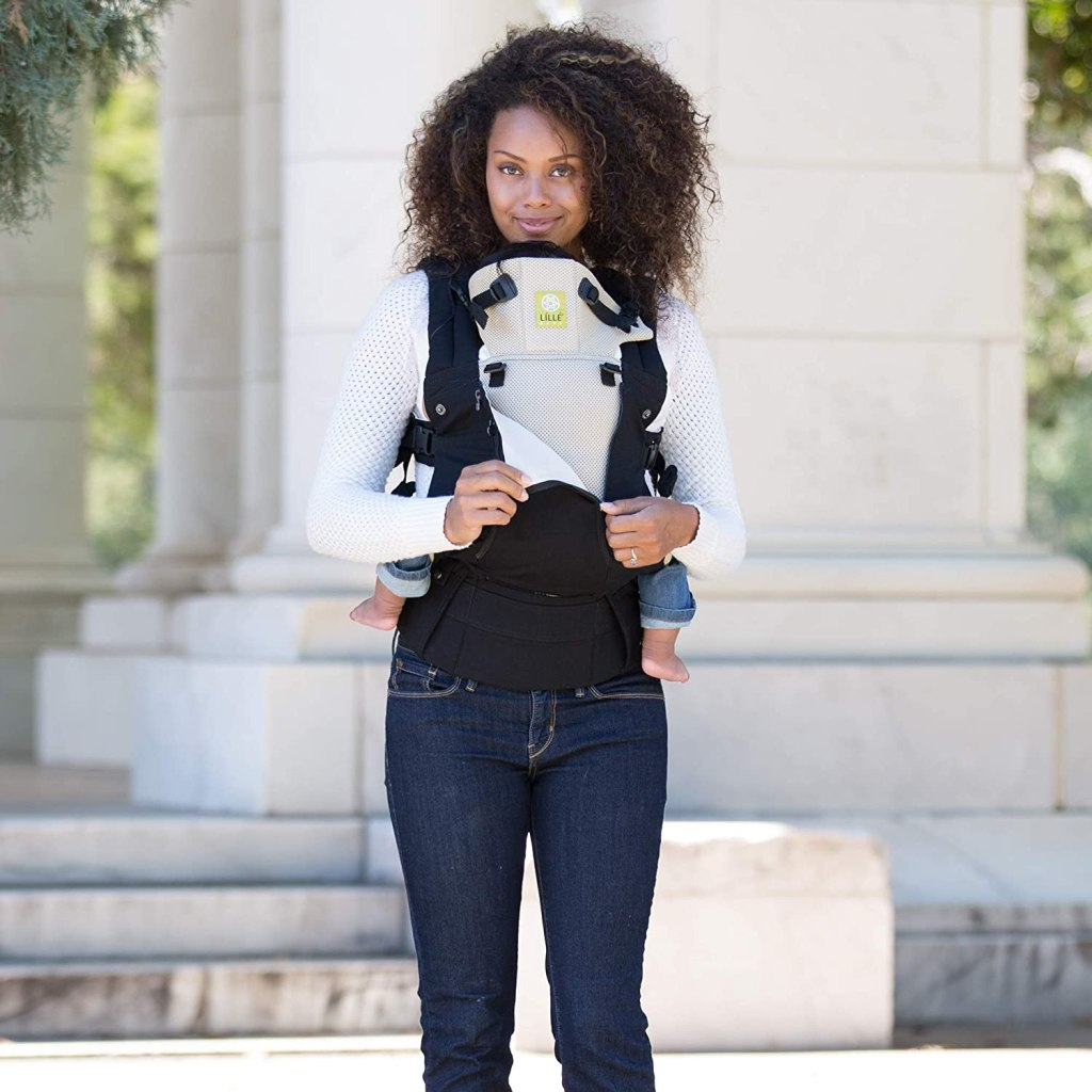 woman wearing baby in Lillebaby complete carrier
