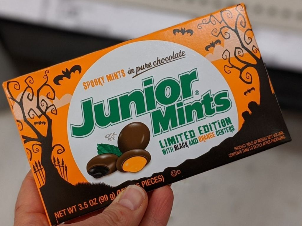 hand holding box of Halloween Junior Mints