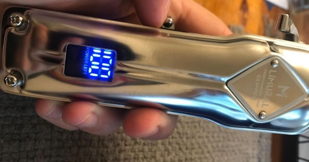 close up of Limural Hair Clippers with battery percentage showing