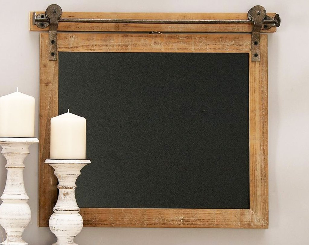 wood framed chalkboard with farmhouse slider accents