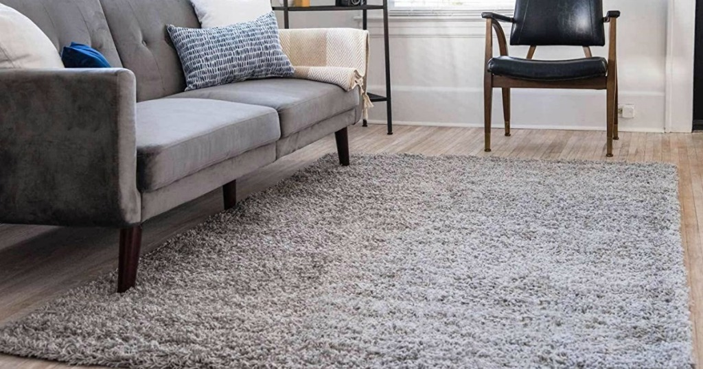 light gray Loom Rug under couch and accent chair