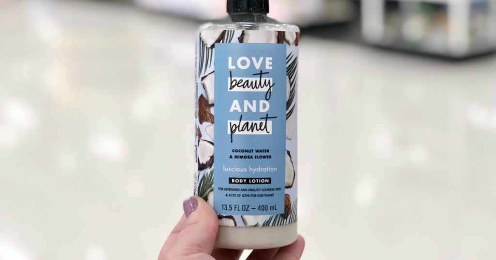 hand holding up Love Beauty Planet lotion