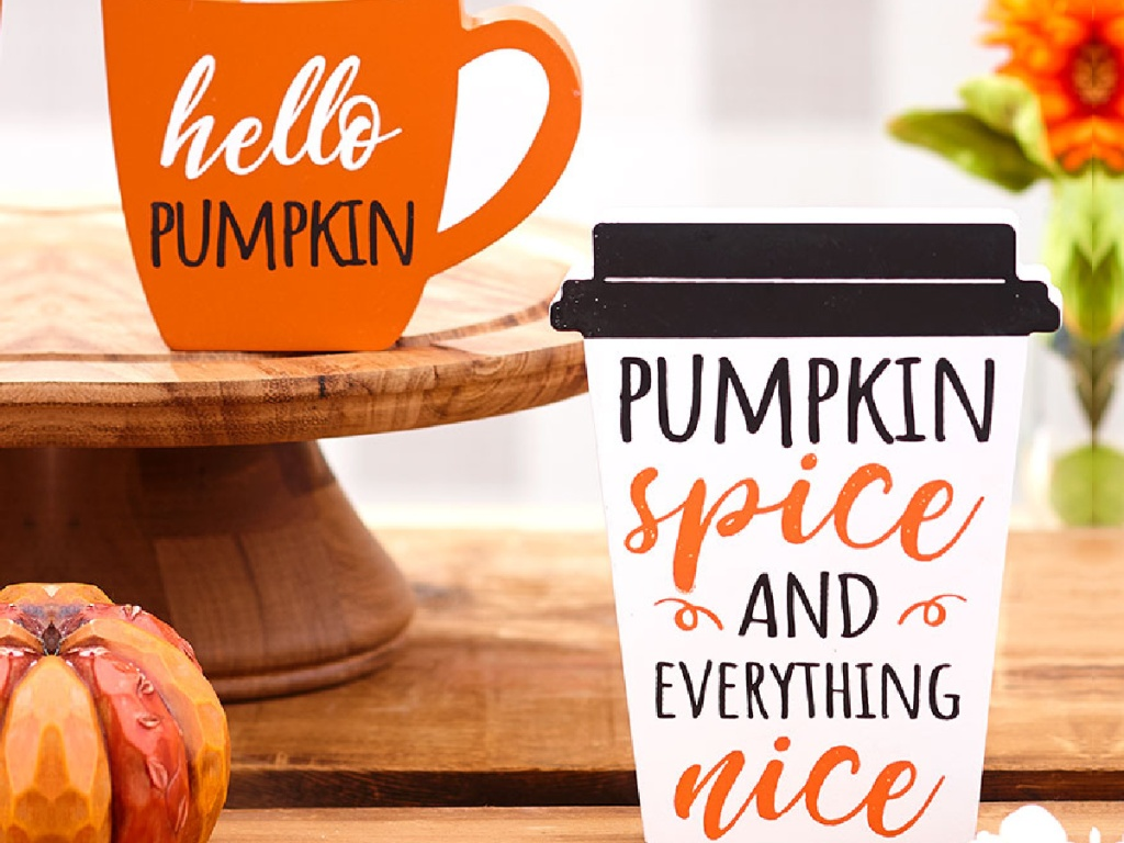 2 wooden fall drink signs sitting next to a pumpkin and plants