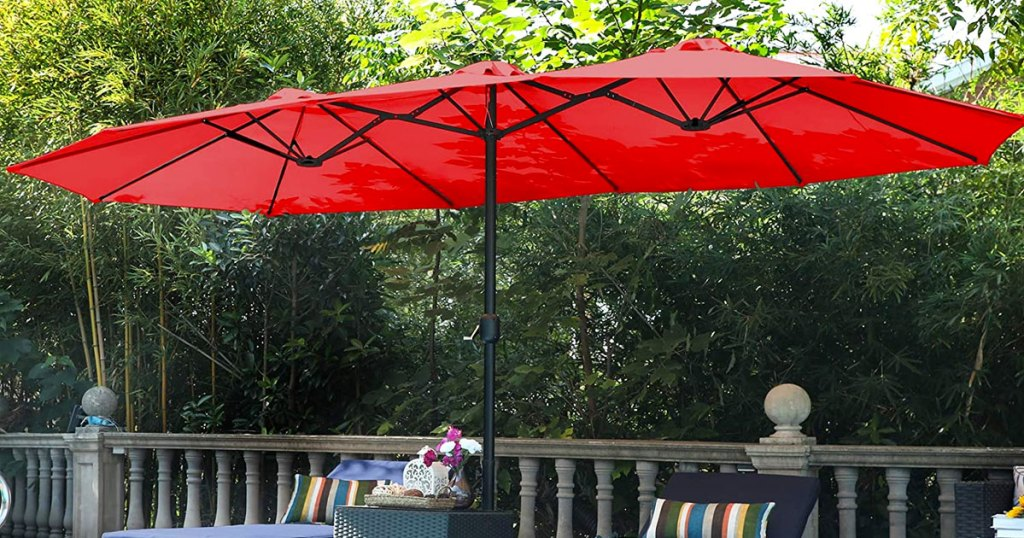 red extra-large patio umbrella in backyard