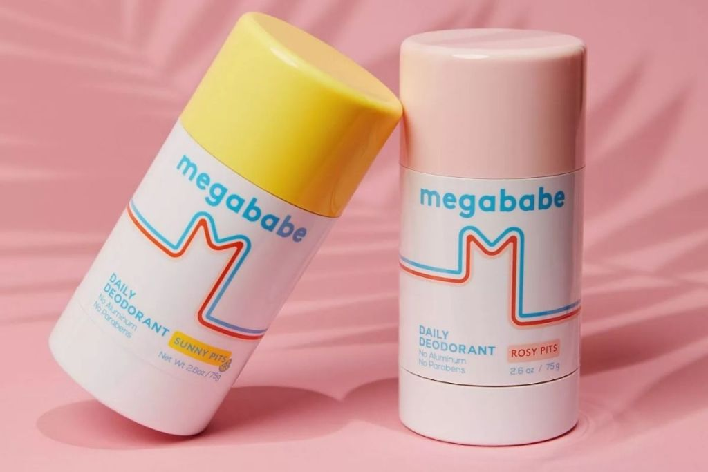 Two megababe deodorant roll-on sticks
