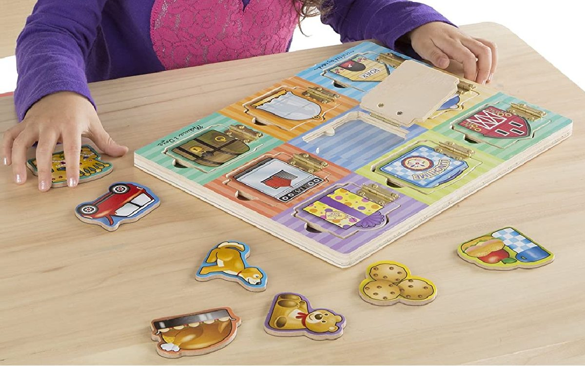 girl playing with magnetic puzzle board on table