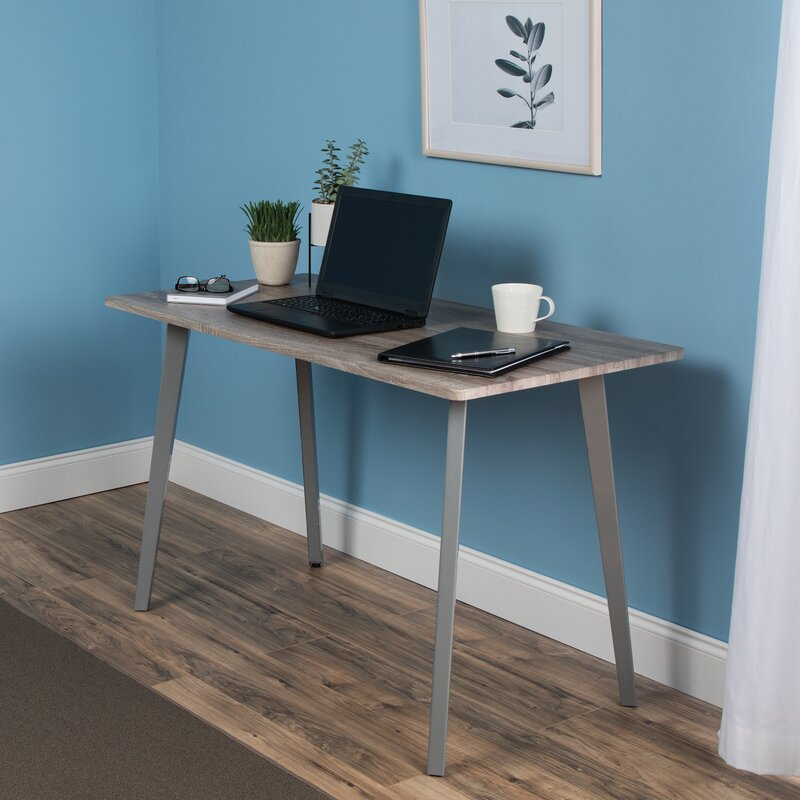 small desk against blue wall