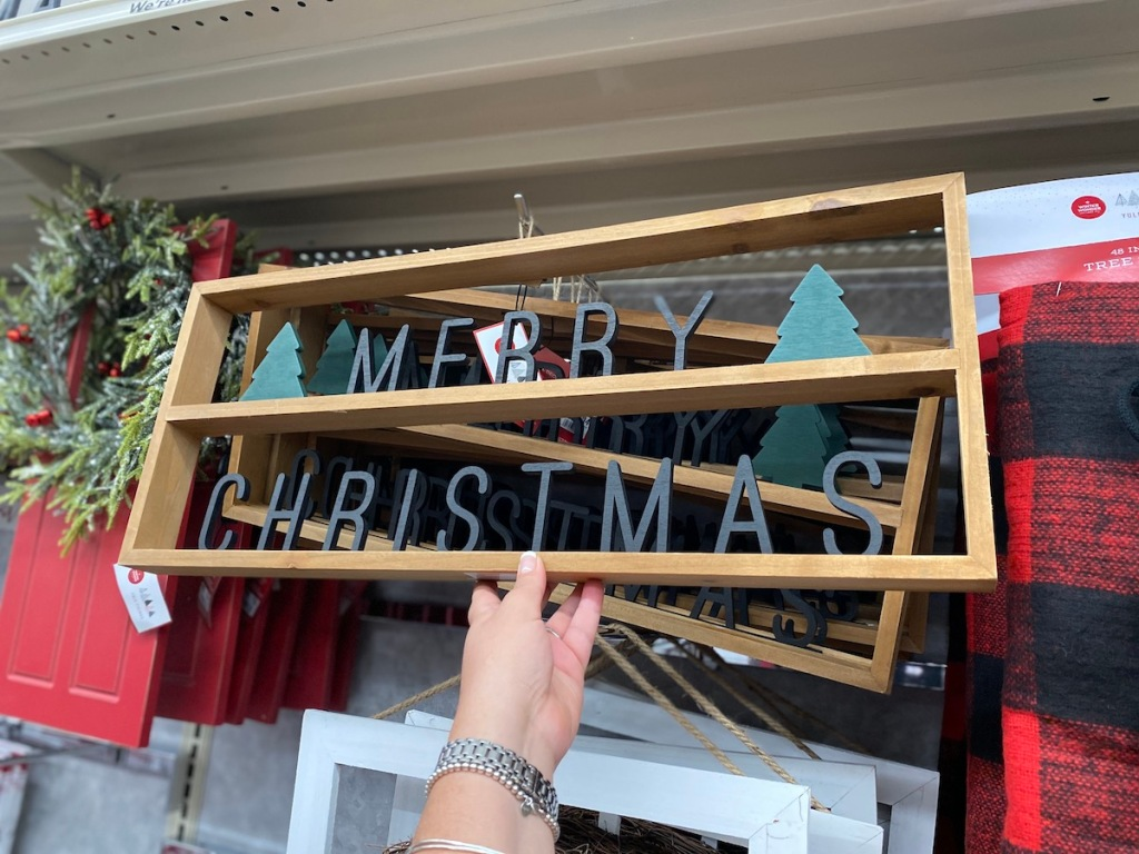 merry christmas metal and wood sign on shelf at big lots