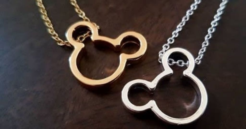 two necklaces with pendants shaped like mickey mouse heads
