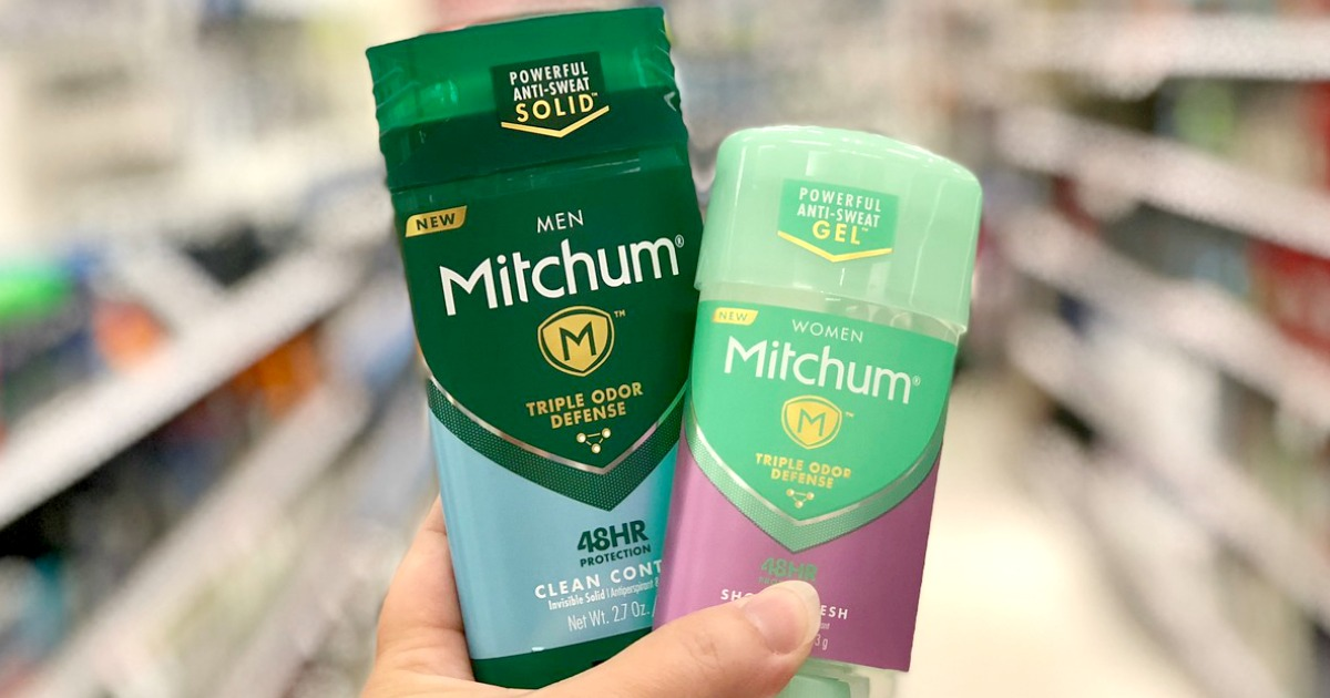 Hand holding two deodorants in-store