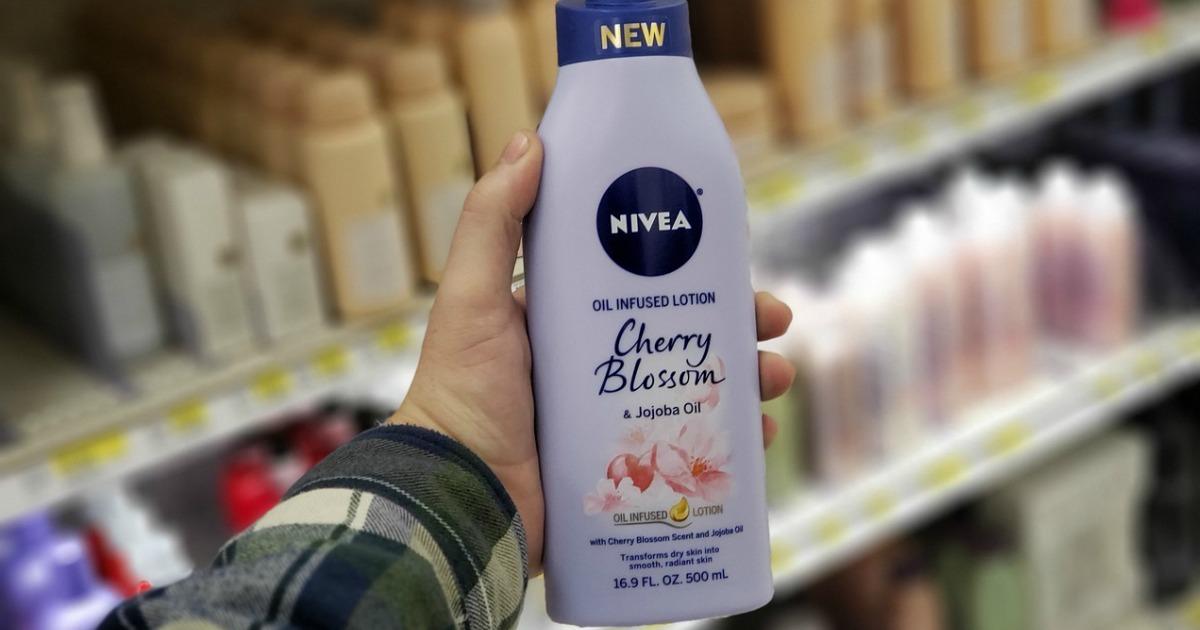 hand holding bottle of nivea cherry blossom lotion