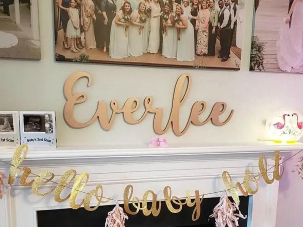 Large kids name sign near fireplace mantel