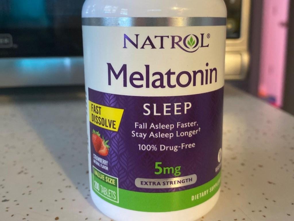 bottle of melatonin tablets on counter