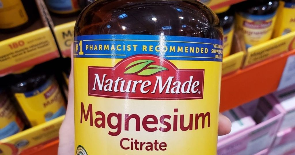 hand holding Nature Made magnesium Citrate in store