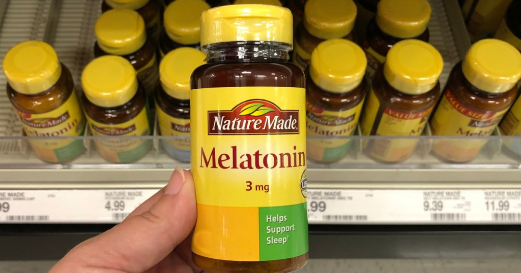 hand holding a bottle of nature made melatonin in store