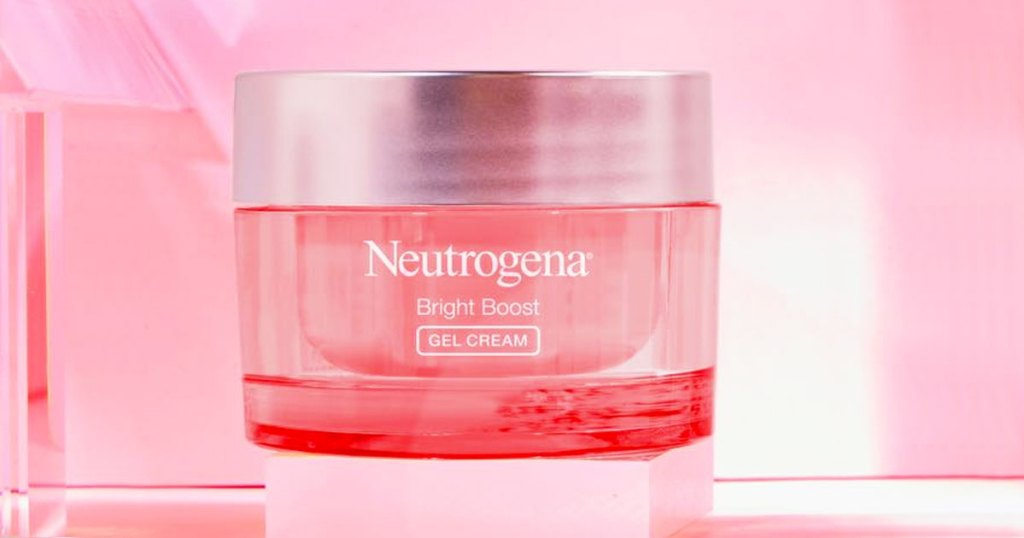 pink jar of Neutrogena Bright Boost face cream on a pink background