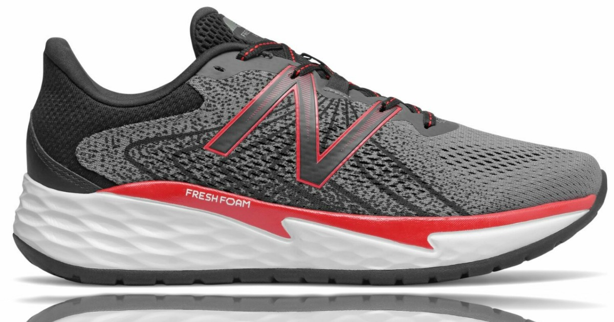stock image of new balance grey black red and white sneakers