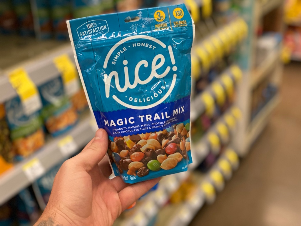 hand holding a bag of trail mix