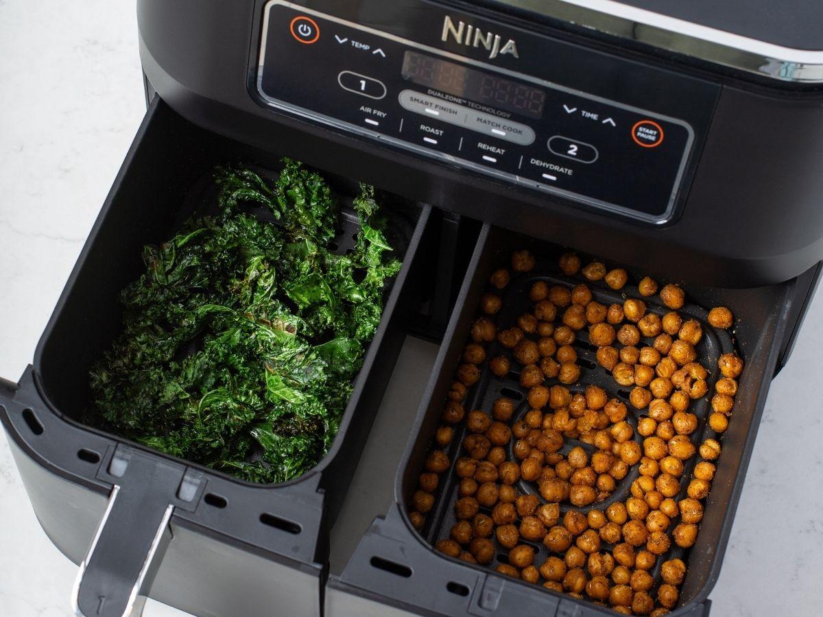 over head basket view of Ninja Foodi Dual Zone Air Fryer with food inside each basket