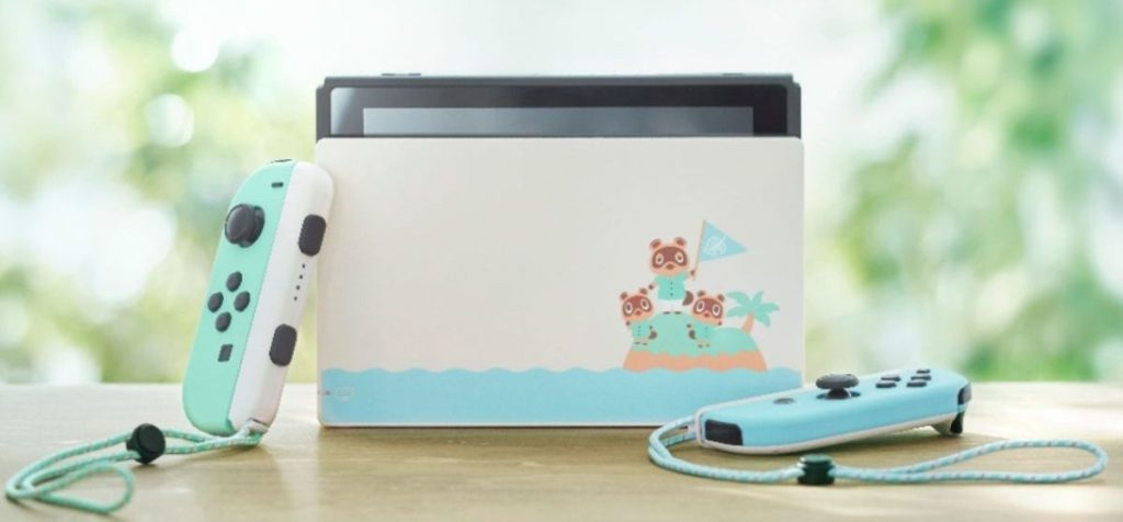Nintendo Switch Animal Crossing Edition in Dock with Joy-Con Controllers Removed laying next to dock