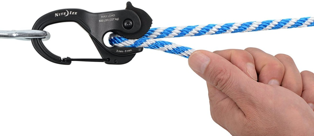 hand pulling white and blue rope from black rope tightener