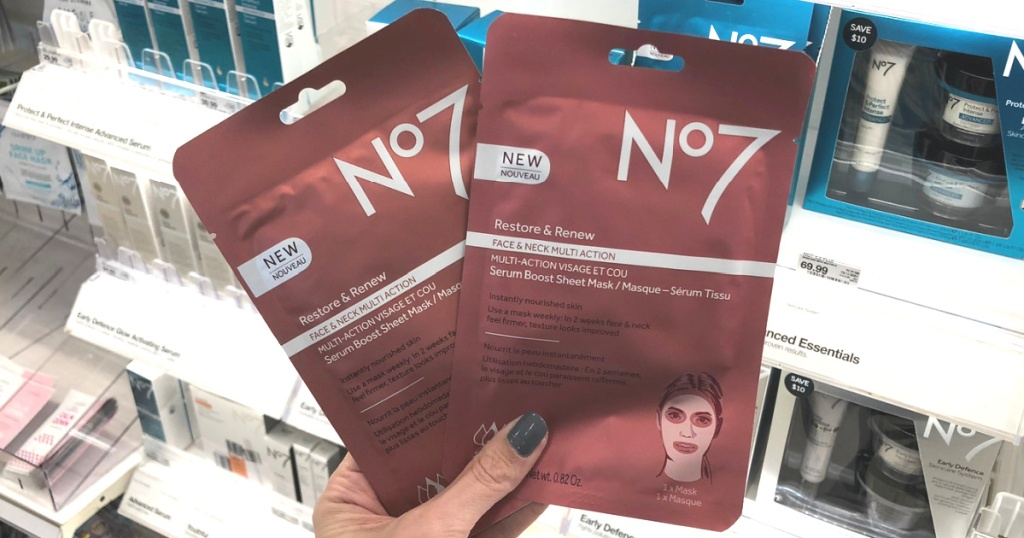 Hand holding 2 No7 beauty serum masks in store