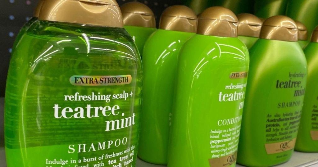 row of OGX shampoo and conditioners on shelf