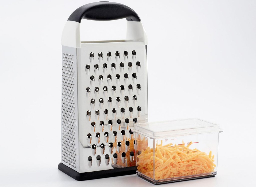 metal box grater with plastic container to catch grated foods