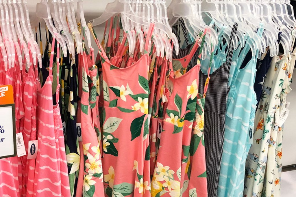 various colors and prints of girls cami tops on plastic hangers