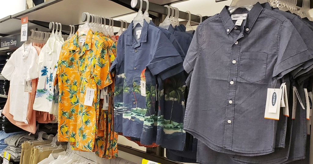 various colors and prints of short sleeve boys button down shirts on hangers
