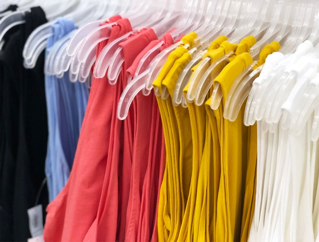 various colors of womens tank tops on hangers