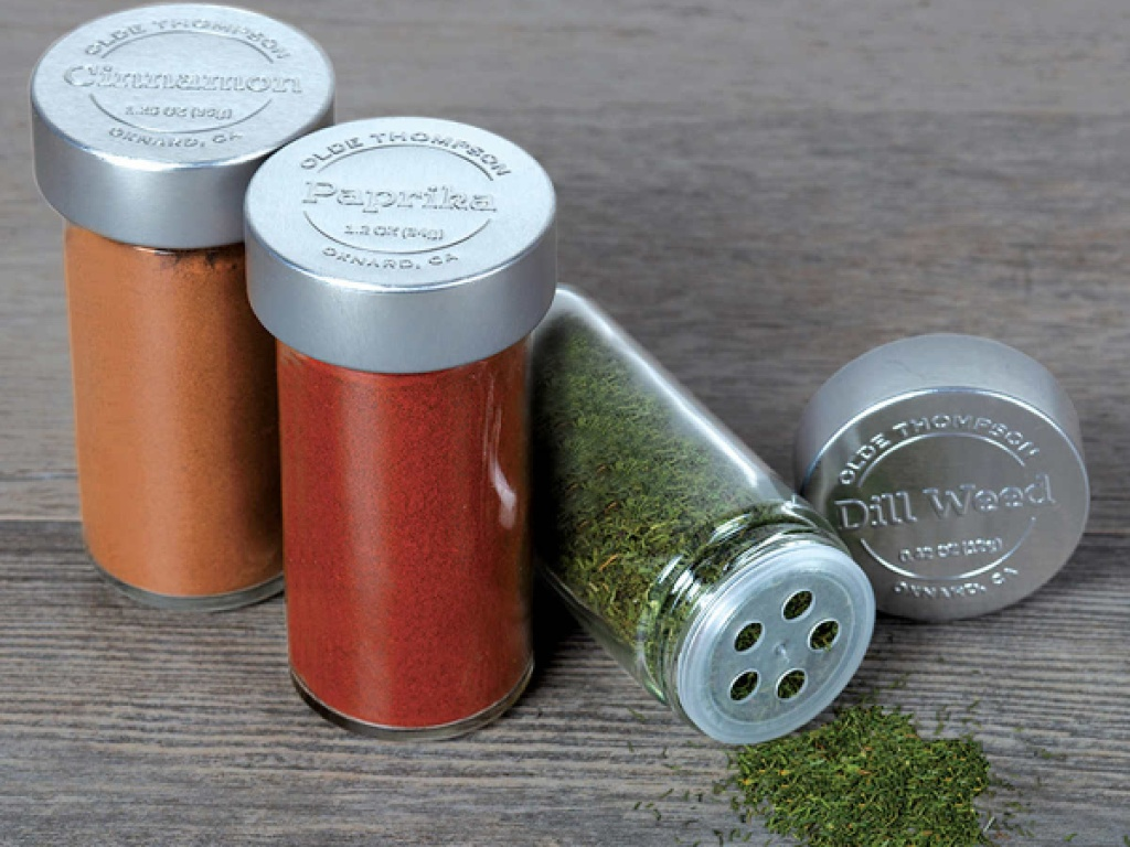 cinnamon, paprika, dill week spices in glass jars