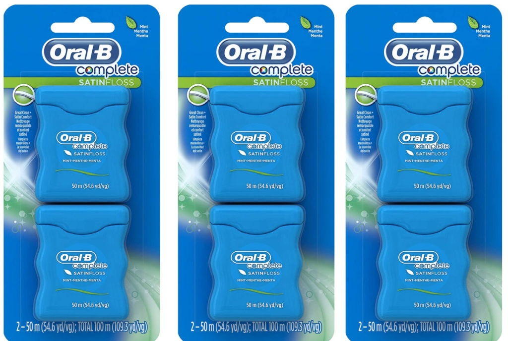 3 package of oral-b satin dental floss sitting side by side next to each other