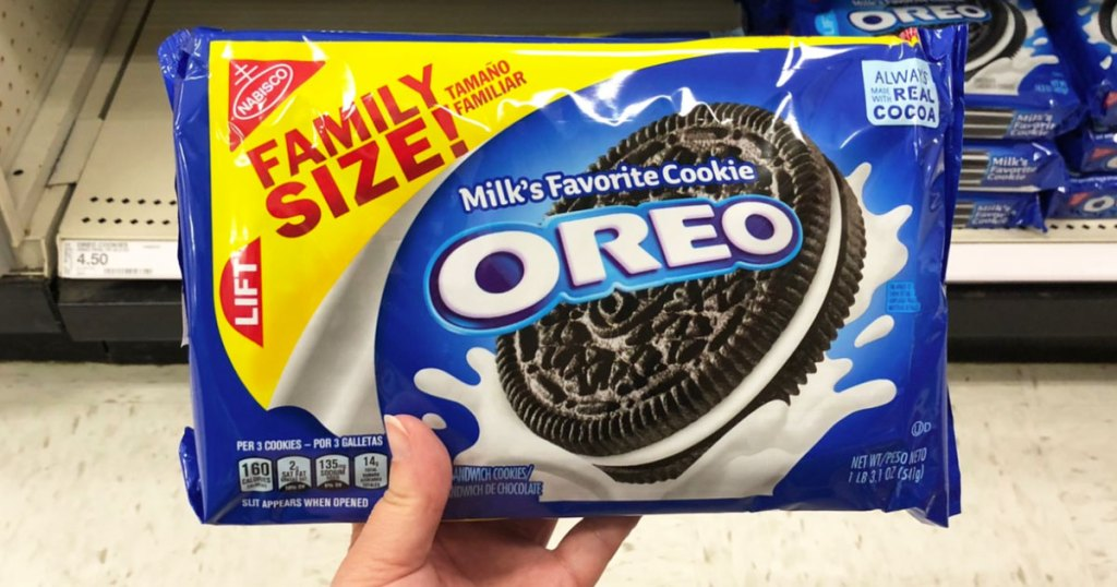 person holding up a family size package of oreo cookies