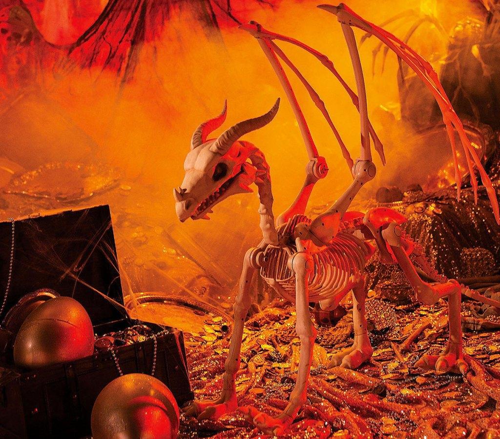 dragon skeleton halloween decoration in orange colored smoke