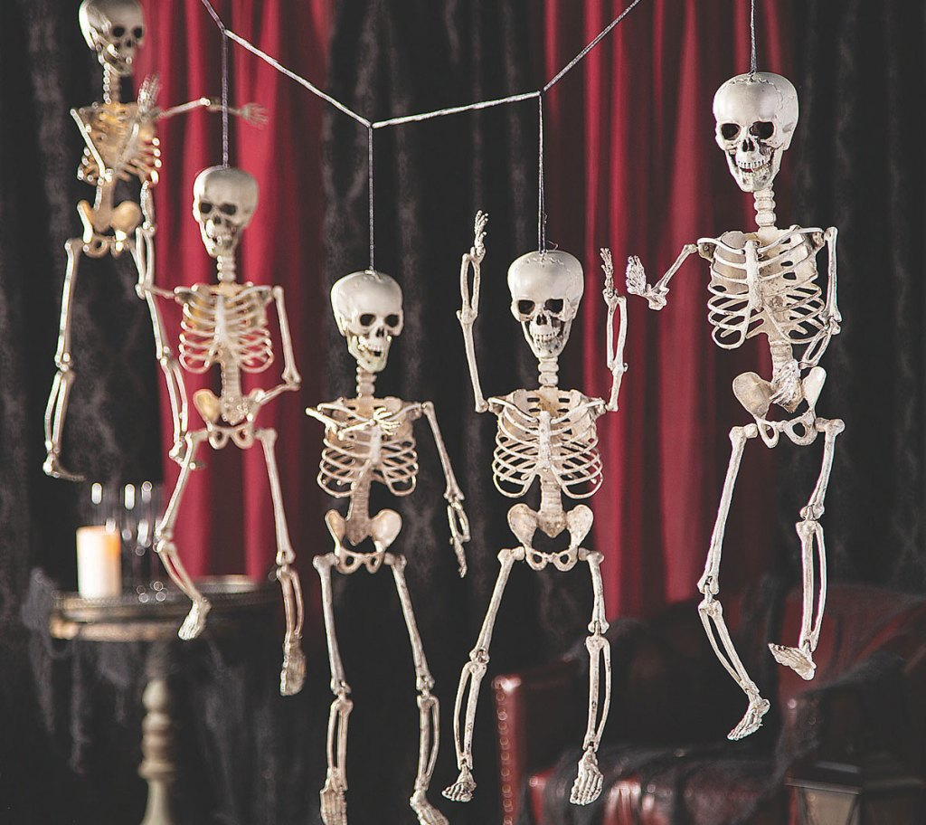 five hanging skeletons on a string halloween decoration