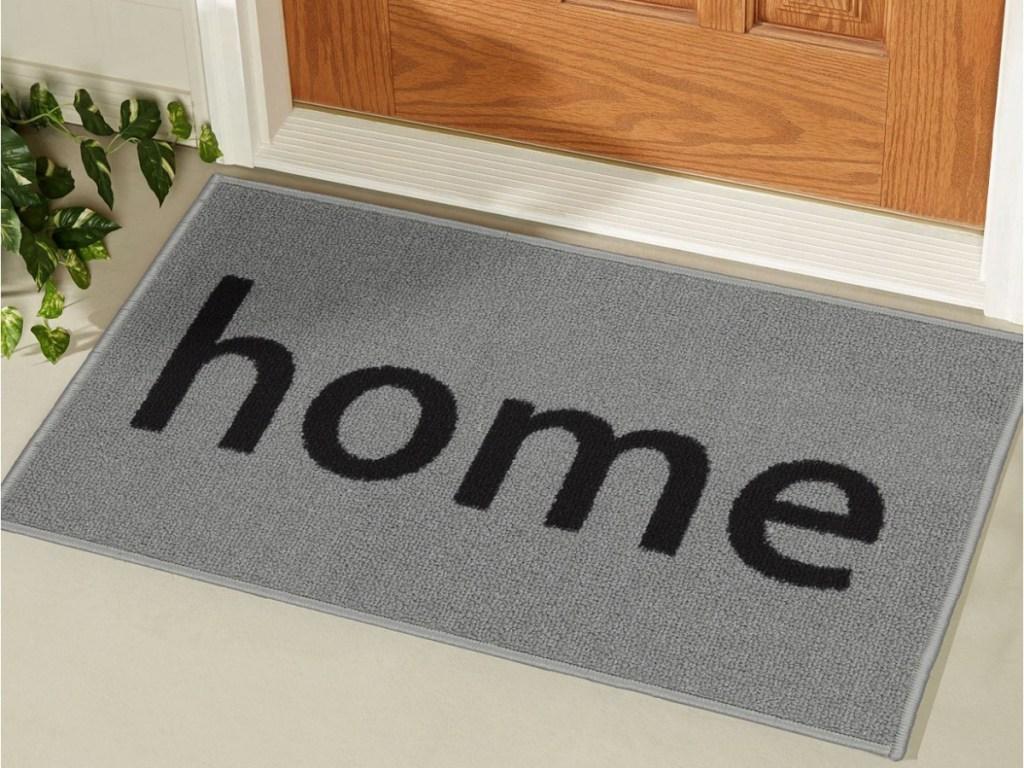 """gray """"home"""" doormat in front of door"""