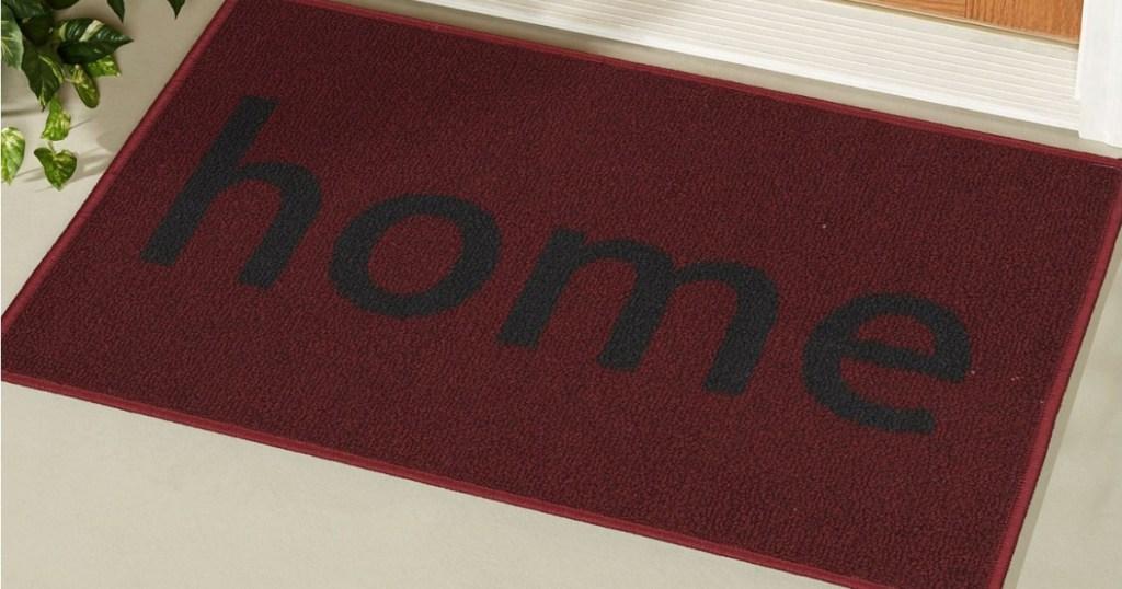 """red """"home"""" doormat in front of door"""
