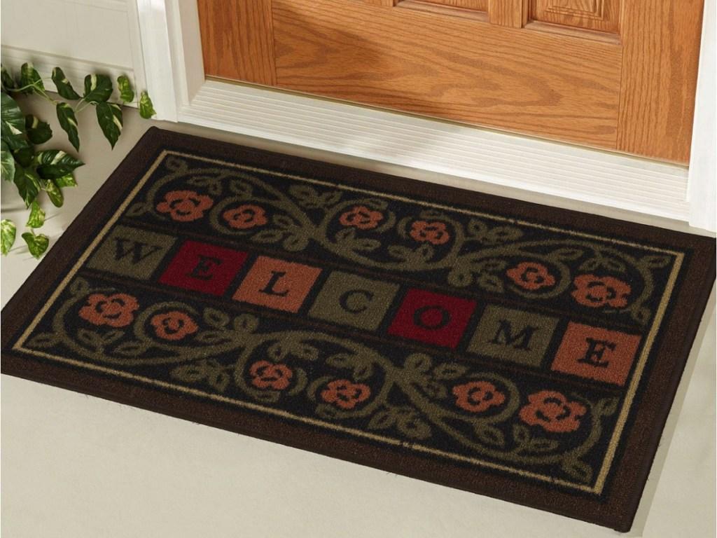 welcome doormat in front of door