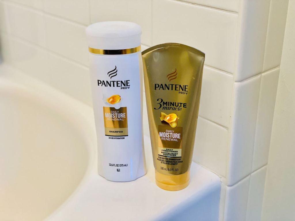 pantene products on side of bathtub