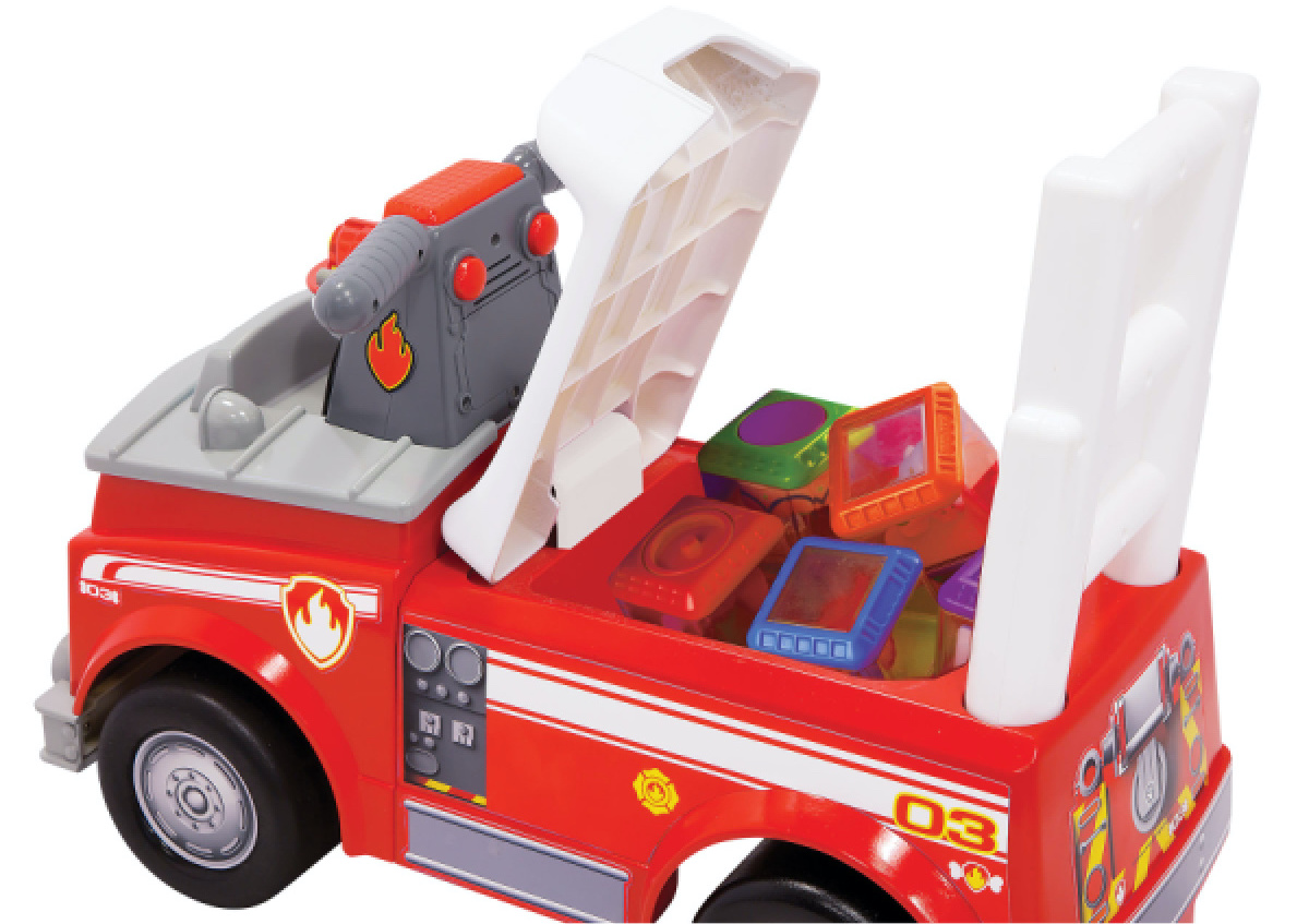 stock image of kids fire truck ride on toy with seat up and blocks in the storage compartment