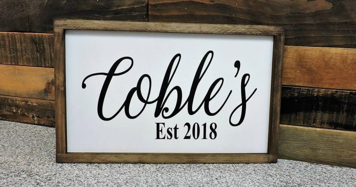 personalized wooden sign on floor near wall