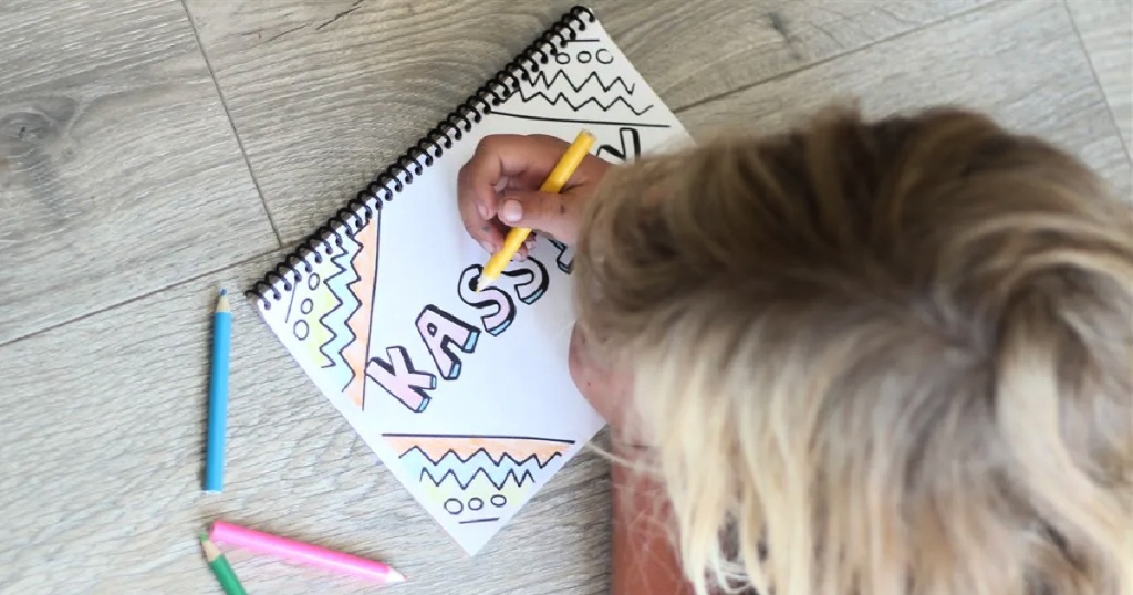girl coloring in a Personalized Coloring Books