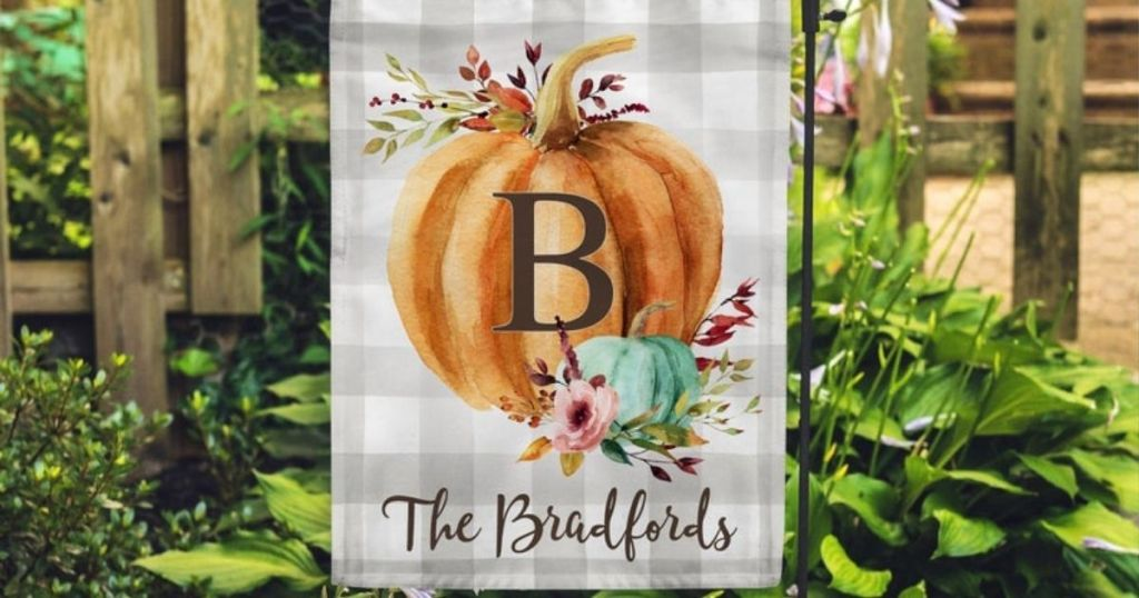 garden flag with pumpkin and family name on it