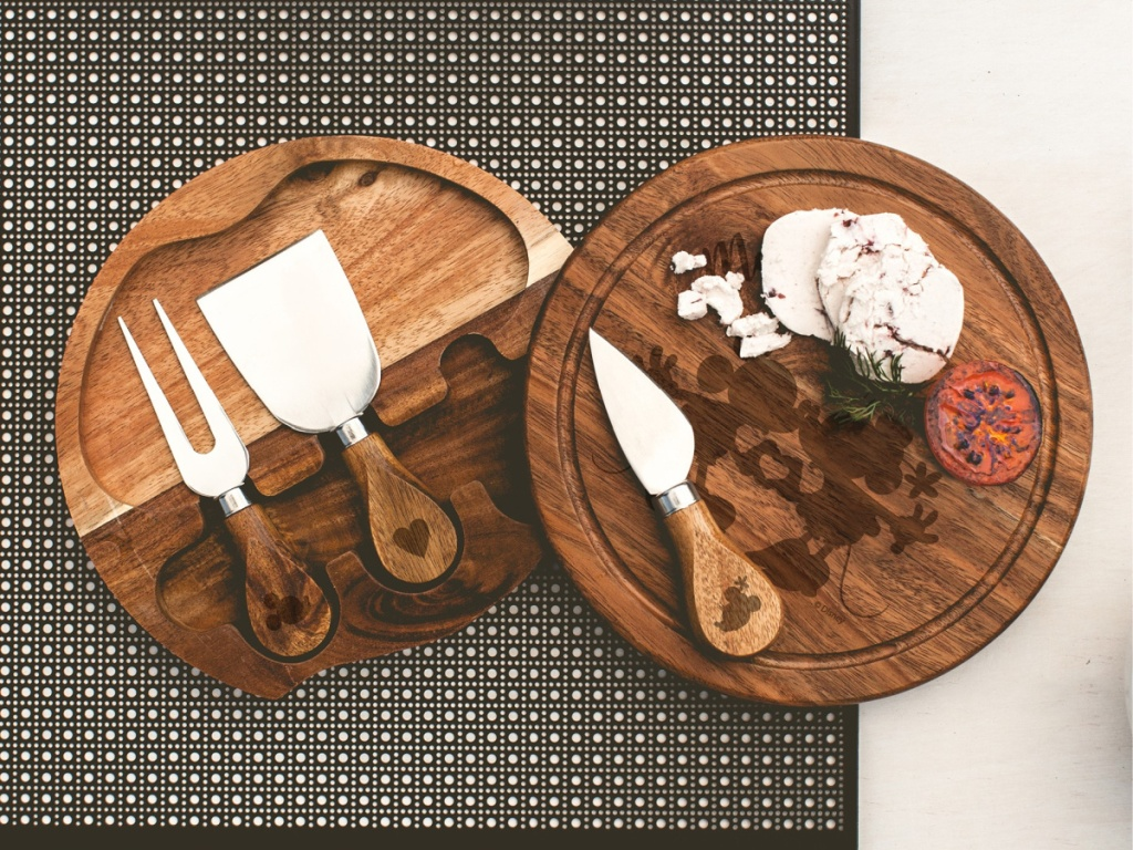 Mickey & Minnie Mouse shaped cheese board, tools, and food on table