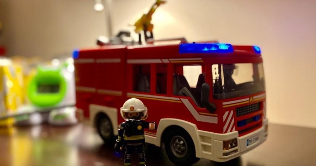 Playmobil fire truck and figure on dresser