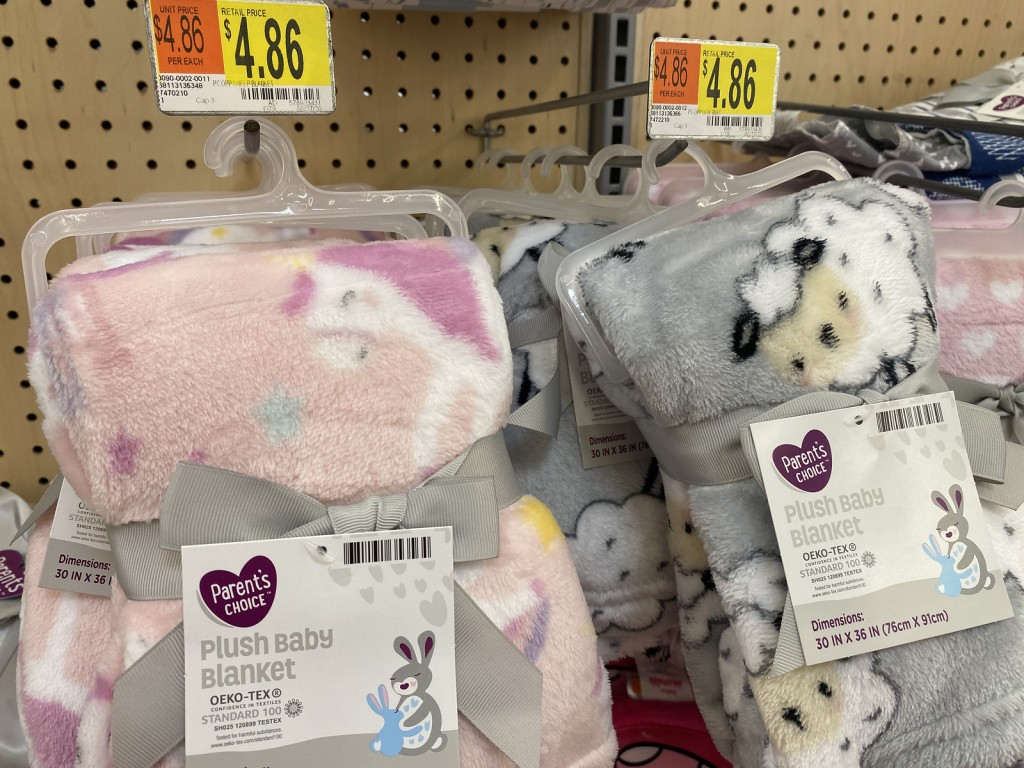 Plush Baby Blankets hanging on peg in walmart