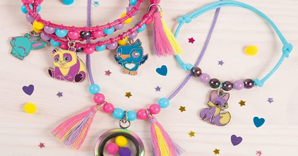 three girls beaded necklaces with tassels and charms on them
