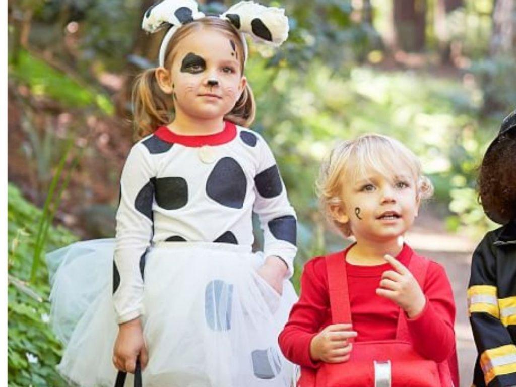Little girl wearing Dalmation costume