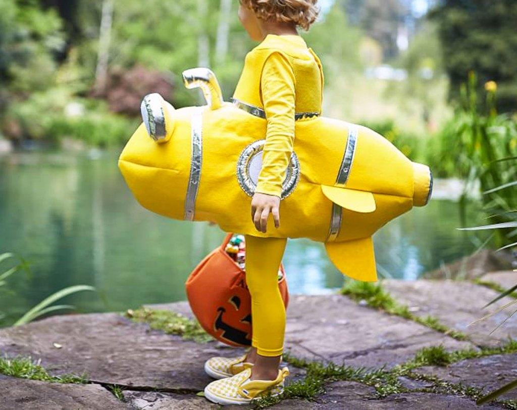 child dressed in yellow submarine halloween costume